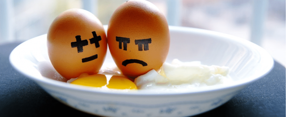 Photo of eggs with unhappy faces painted on them